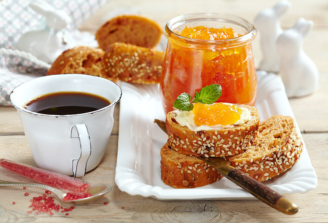 Carrot, apple and ginger preserve for an Easter brunch served with wholemeal baguette and a cup of coffee