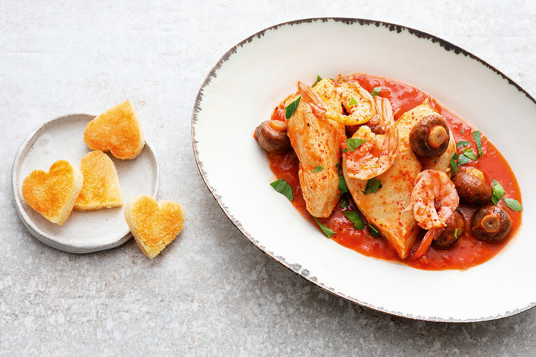 Chicken Marengo with shrimps and bread hearts