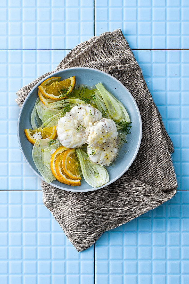 Monk fish steaks with oranges and fennel in orange sauce