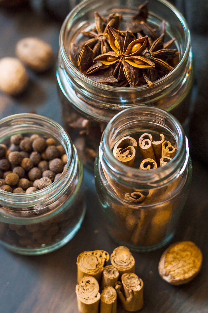 Cinnamon, allspice and star anise in small glass bottles