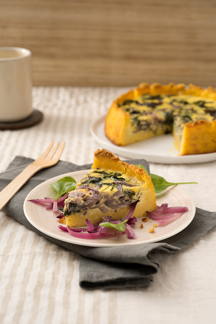 Polenta and pumpkin quiche with red onions and spinach