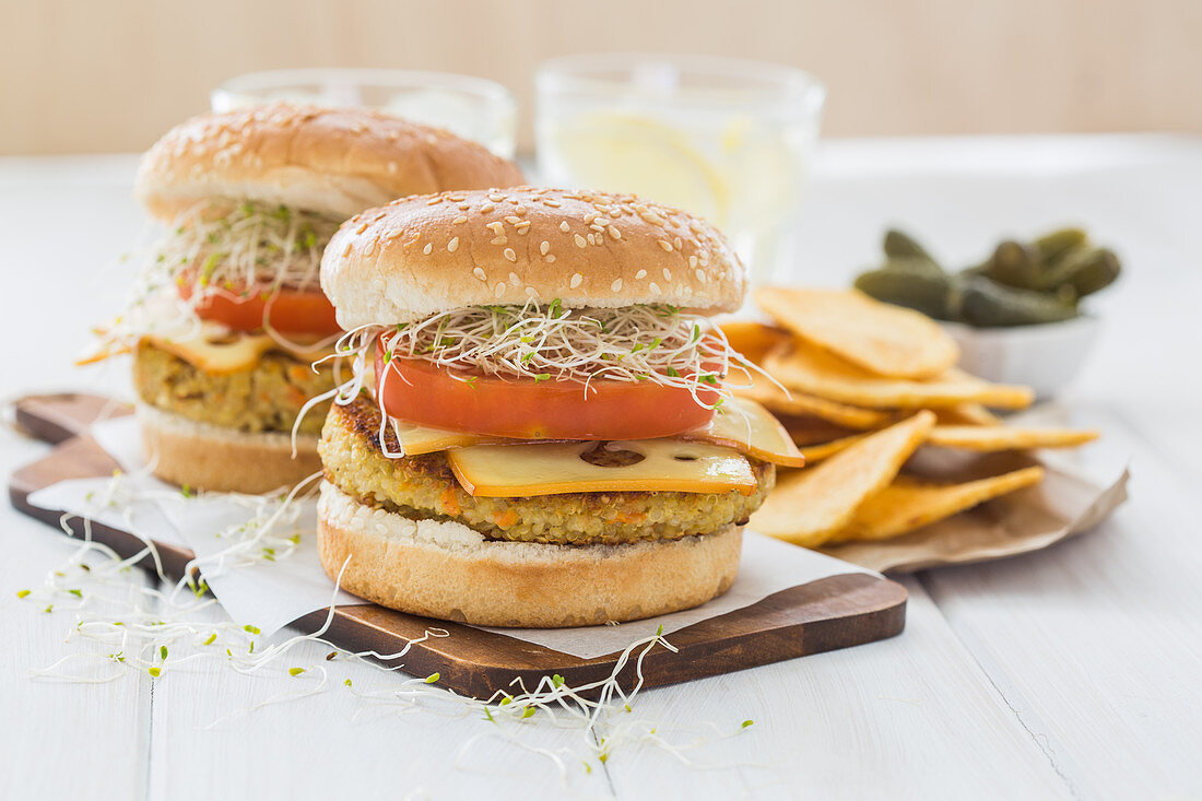 Vegan burger with quinoa, tomato and sprouts