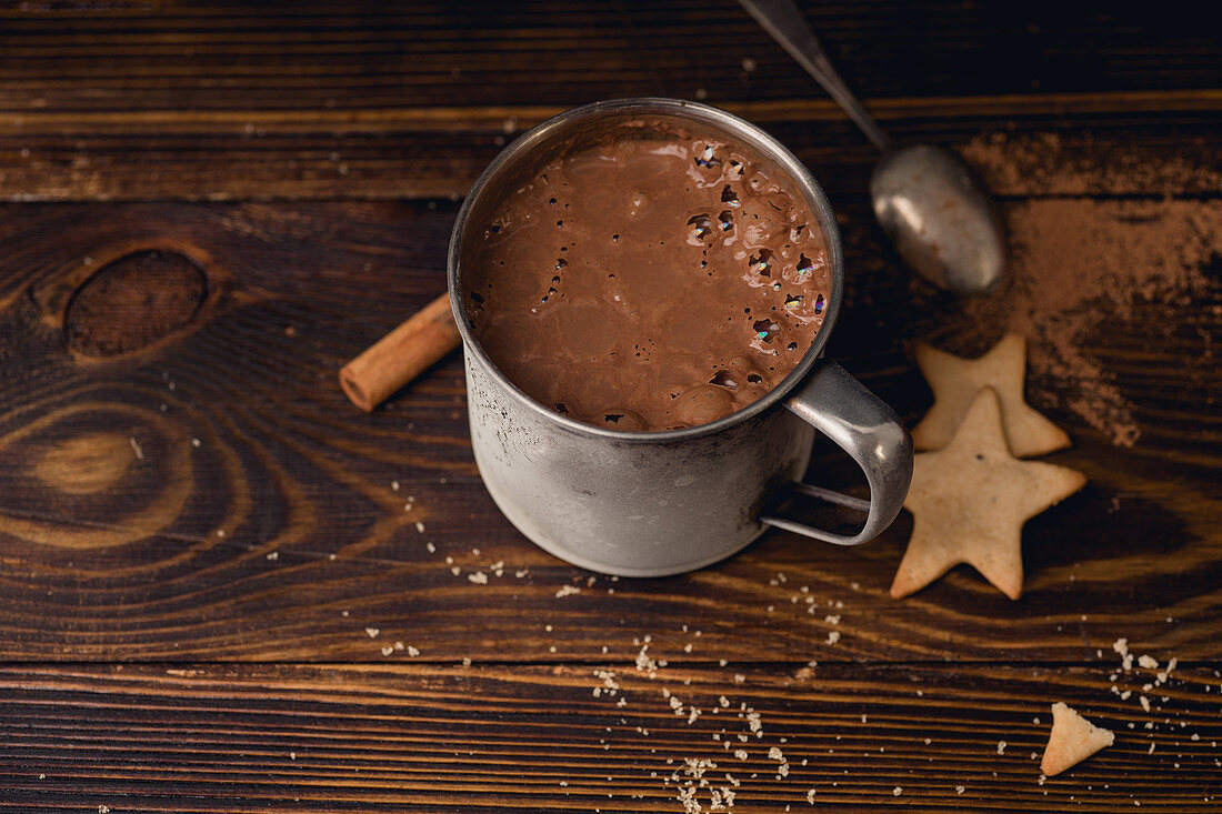 Hot chocolate in a mug with cookies