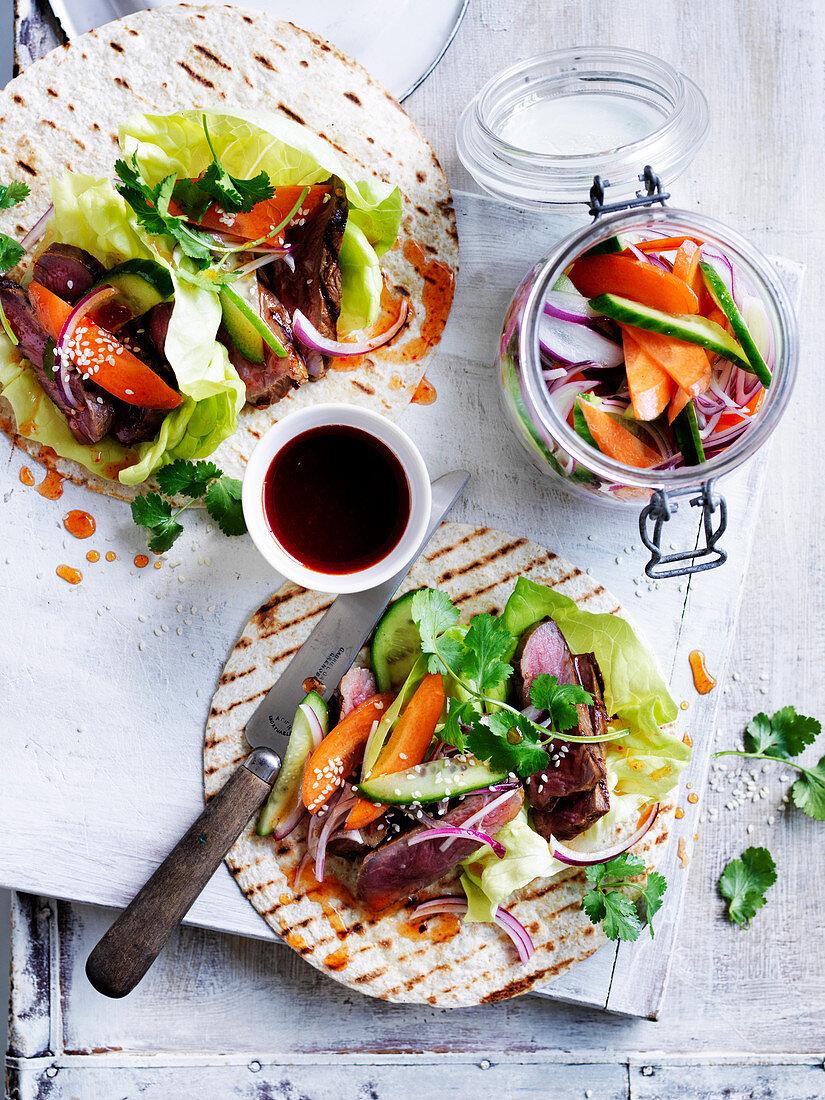 Pickled vegetables with korean steak tacos