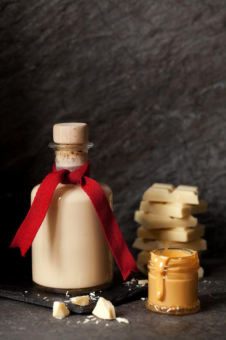 Caramelised White Chocolate Cream Liqueur with a Pot of Caramelised White Chocolate