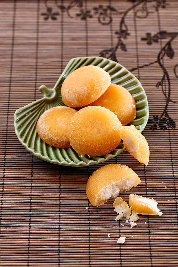 Palm sugar in a ceramic bowl