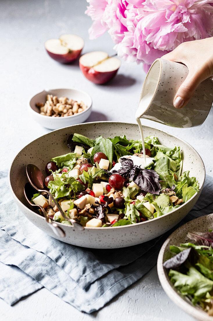 Waldorf salad with chicken being prepared