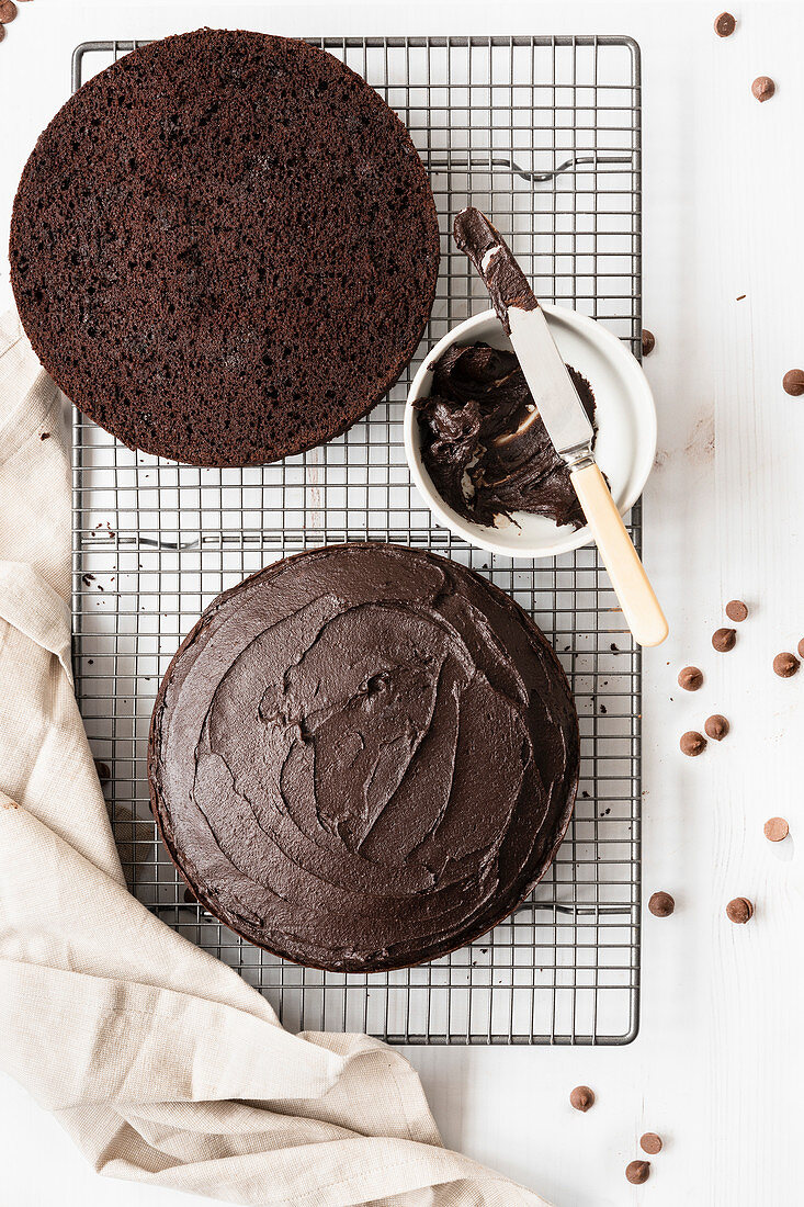 Gluten-free chocolate cake covered with chocolate icing and cut in halves