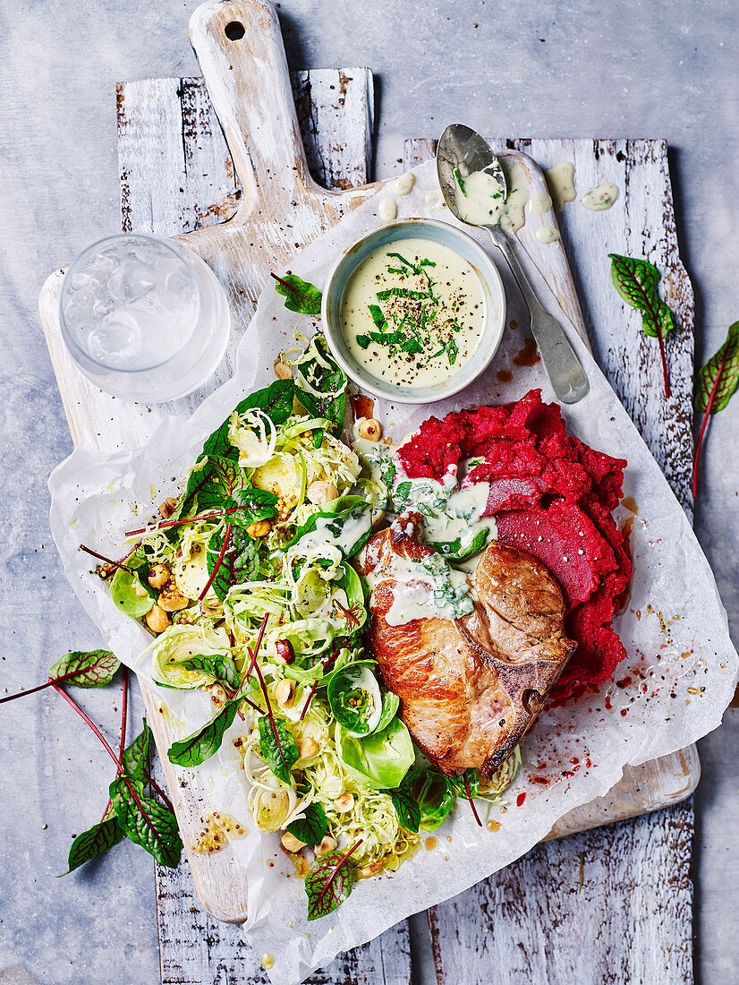 Pork with beetroot mash and sprout salad