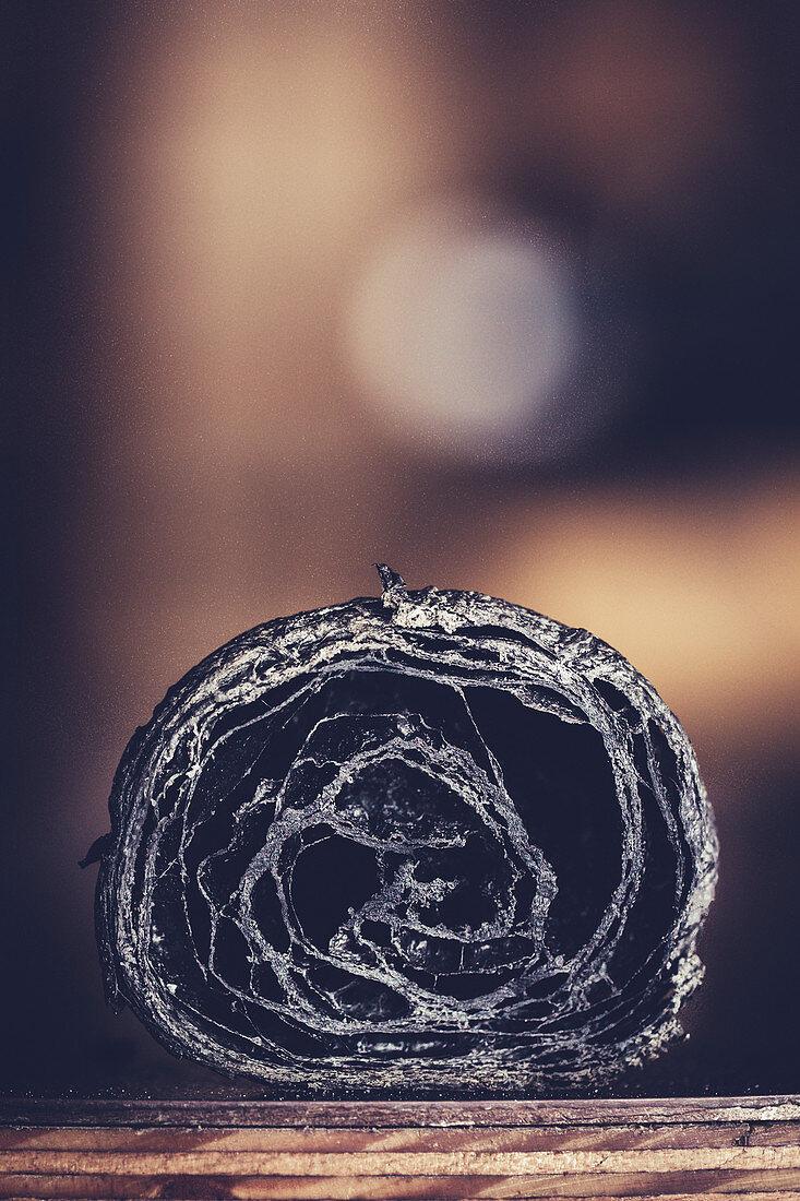 Black croissants with active charcoal powder (detail, close-up)