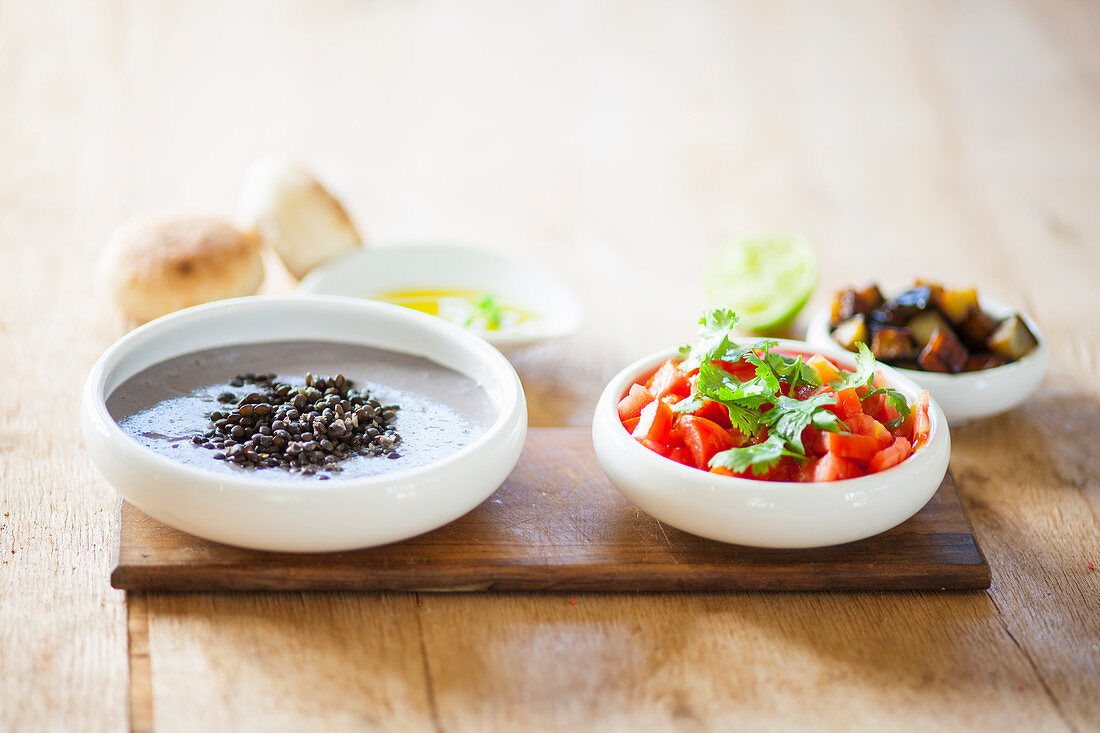 Black lentils, tomatoes and eggplants for making Sabich (sandwich, Israel)