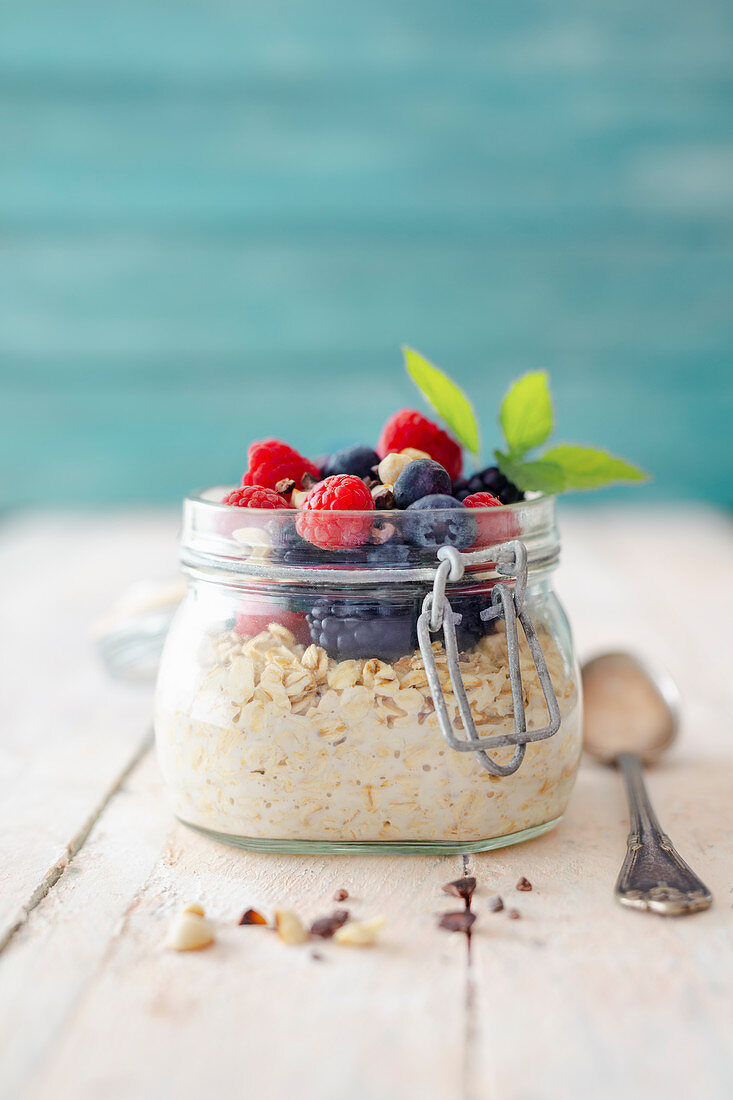 Overnight oats with fresh berries in a flip-top jar