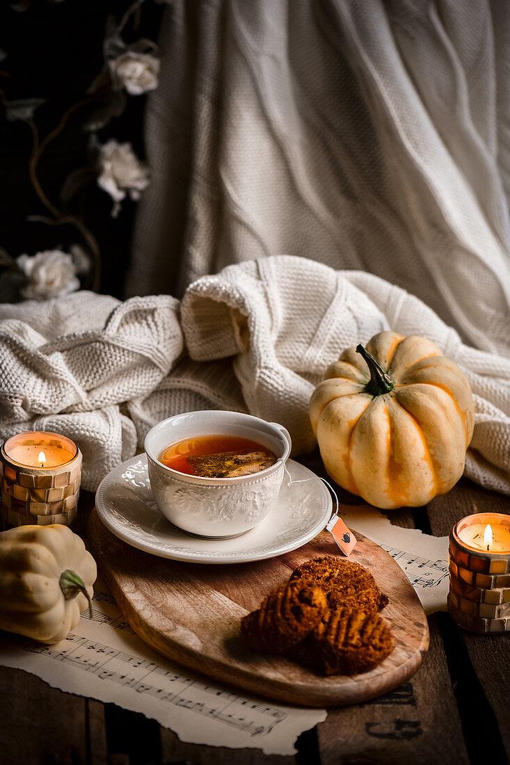 Pumkin cookies and sastuma rooibos tea in an autumn setting