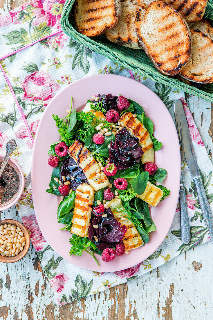 Roasted beetroot, raspberry, grilled cheese salad with poppy seed and balsamic