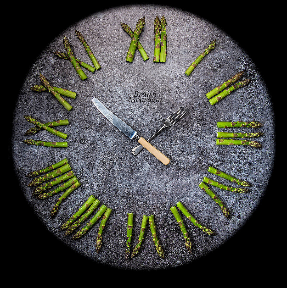 A clock with asparagus Roman numerals and cutlery hands