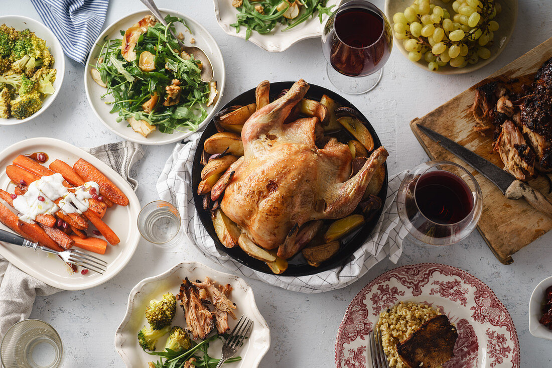 Big festive dinner with roasted chicken and various garnishing