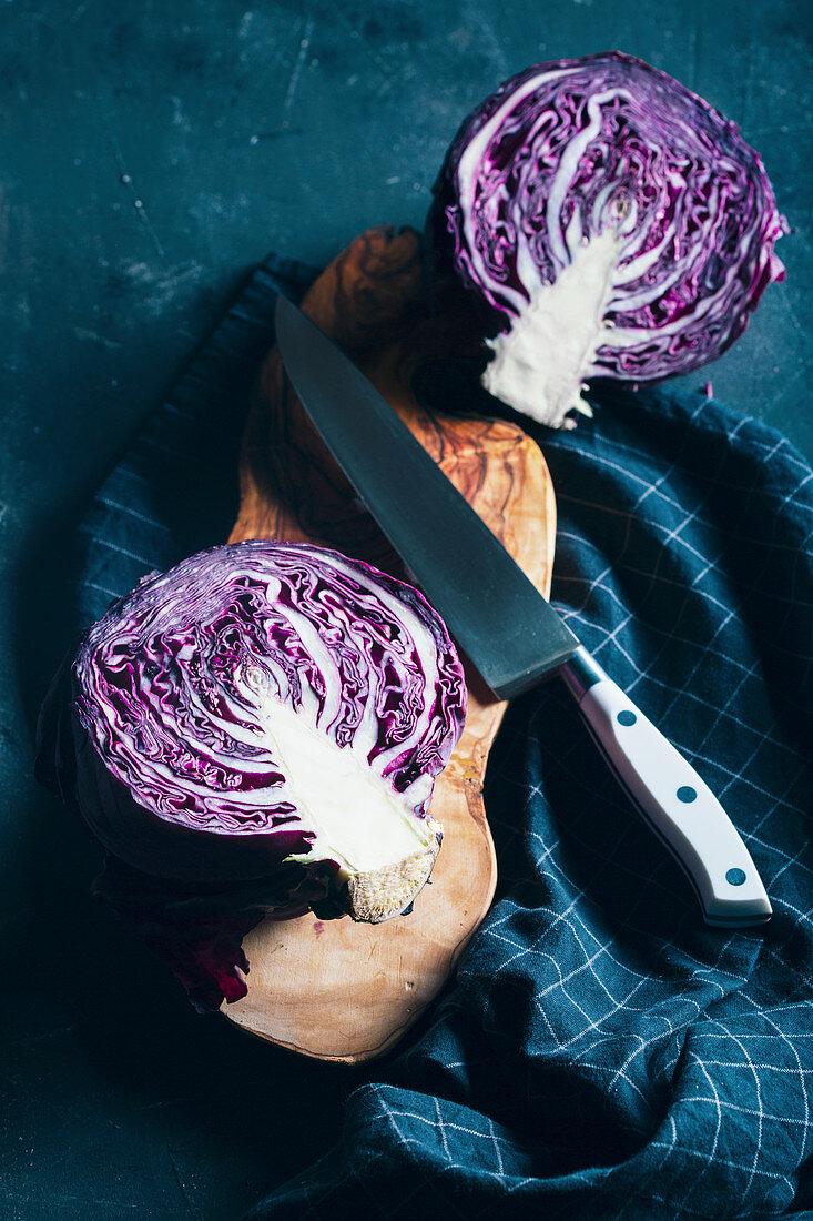 Halved red cabbage on dark background