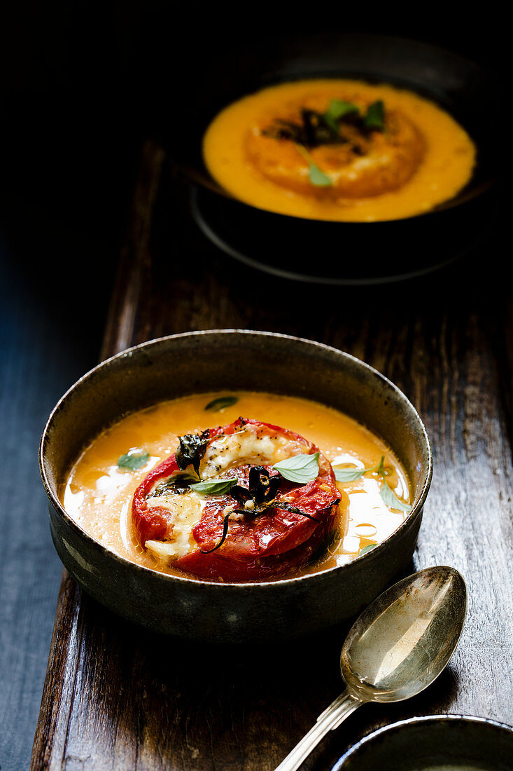 Yellow tomato soup with a grilled tomato