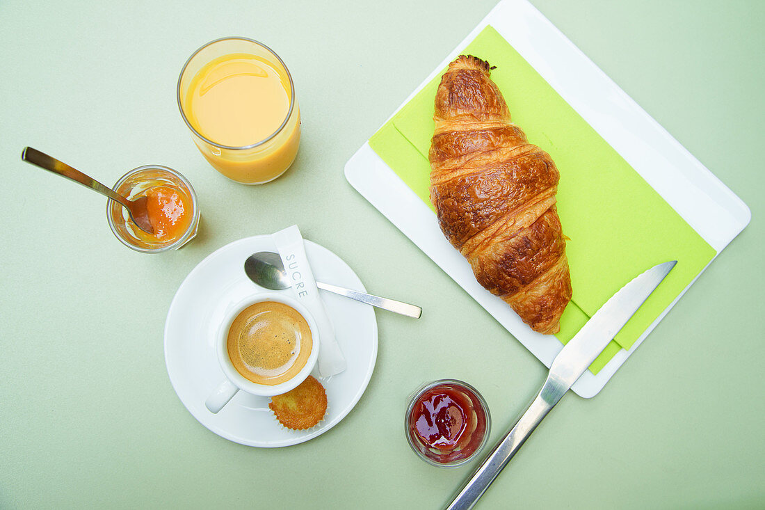 French breakfast - Coffee, croissant, marmelade, orange juice