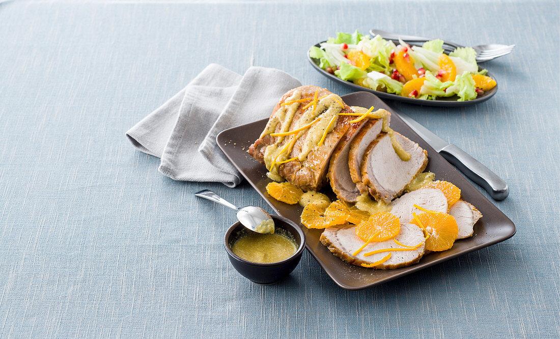 Gently cooked orange and leek pork loin with orange sauce