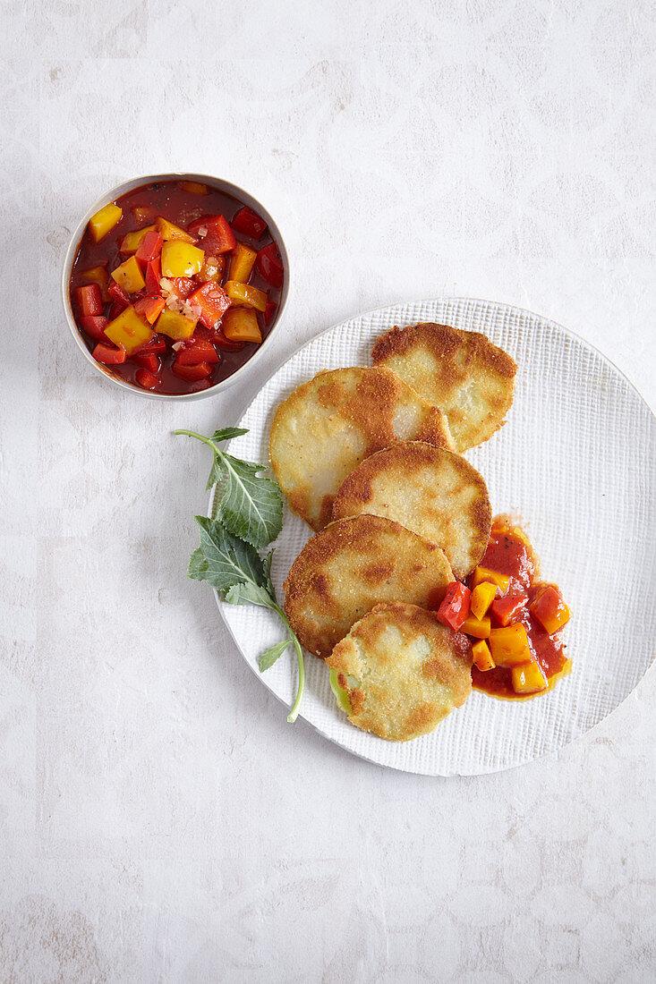 Breaded kohlrabi escalopes with a pepper medley