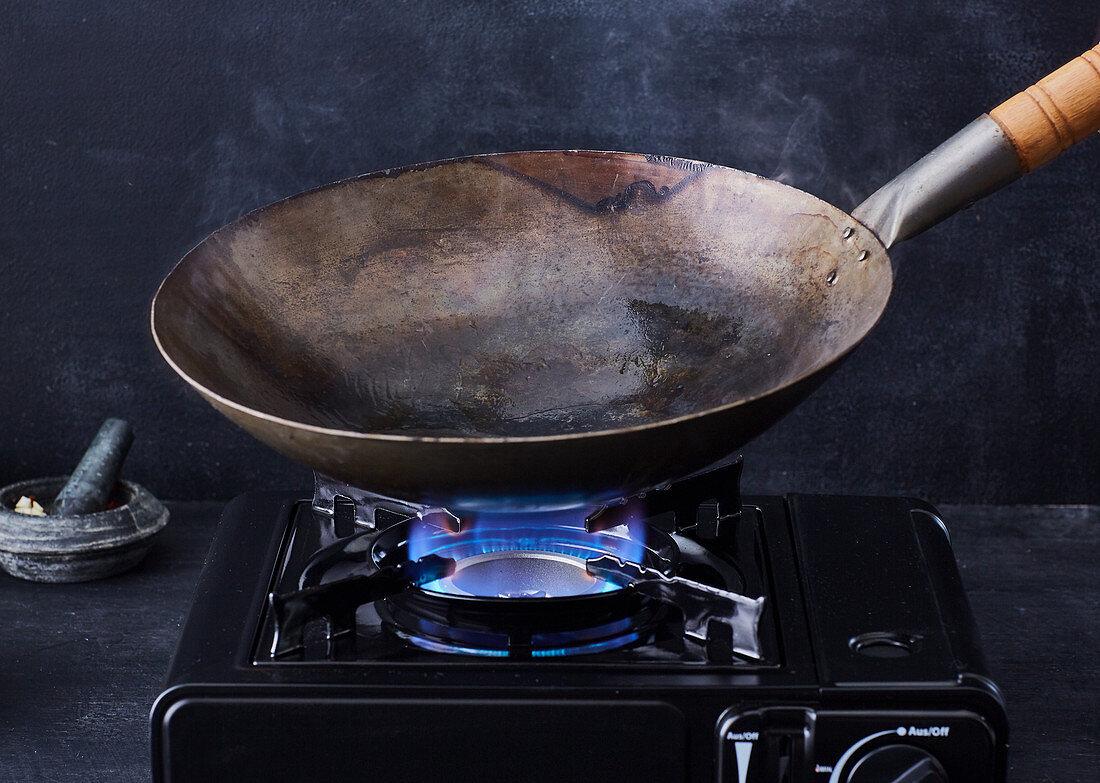 A wok being heated