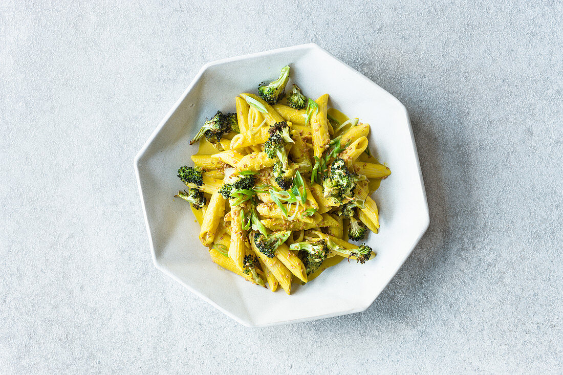 Penne with tahini sauce and oven-baked potatoes