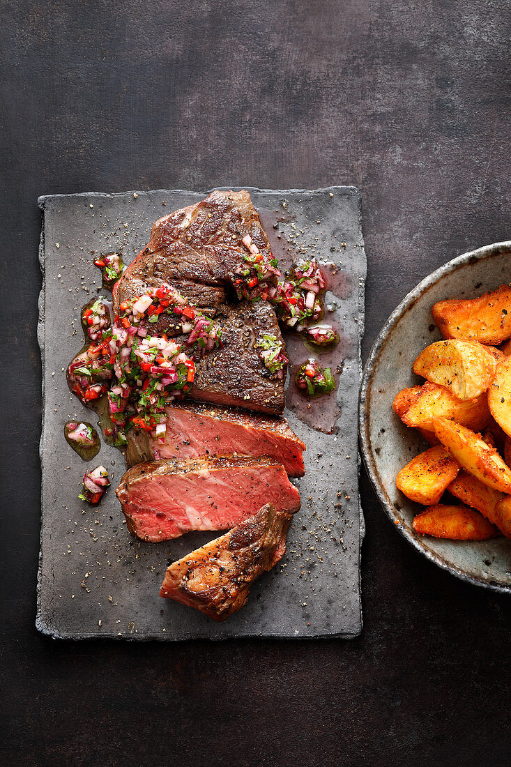 Sous vide chuck steaks with chimichurri and potato wedges