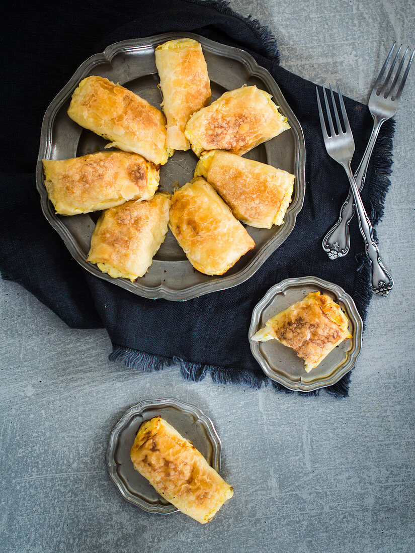 Traditional pumpkin puff pastry strudel with cream cheese