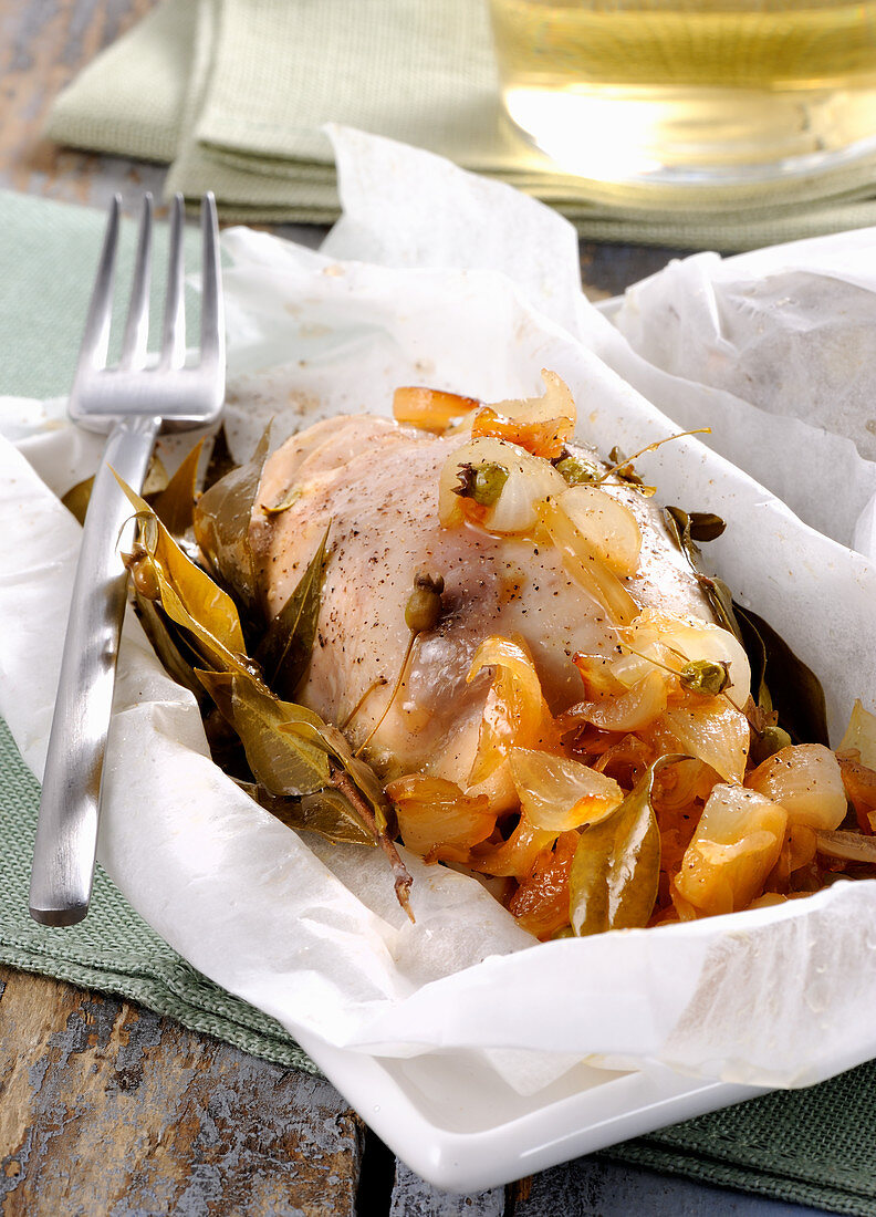 Corsican-style chicken roulade with onions, capers and lemon leaves