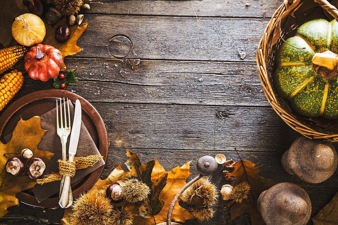 Autumn fruit with plate and cutlery for Thanksgiving dinner