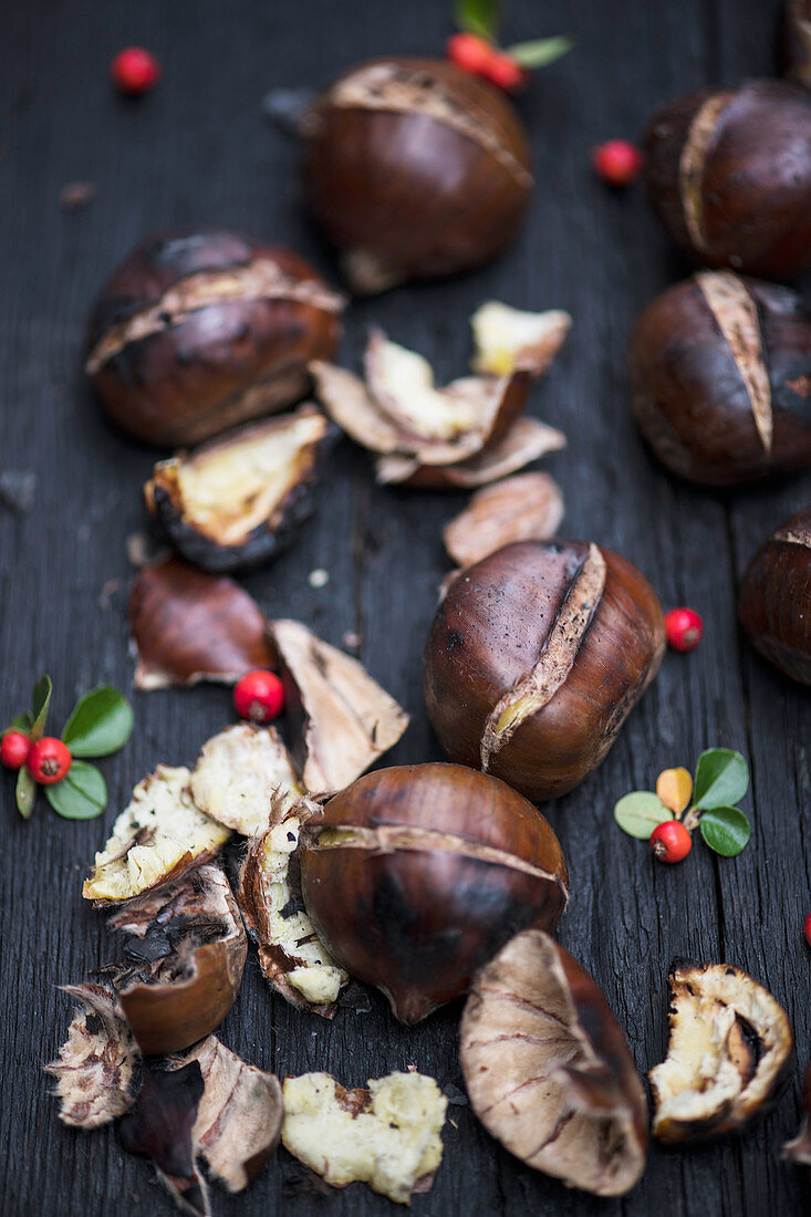 Roasted chestnuts displayed on the wooden table ready for cleaning and eating