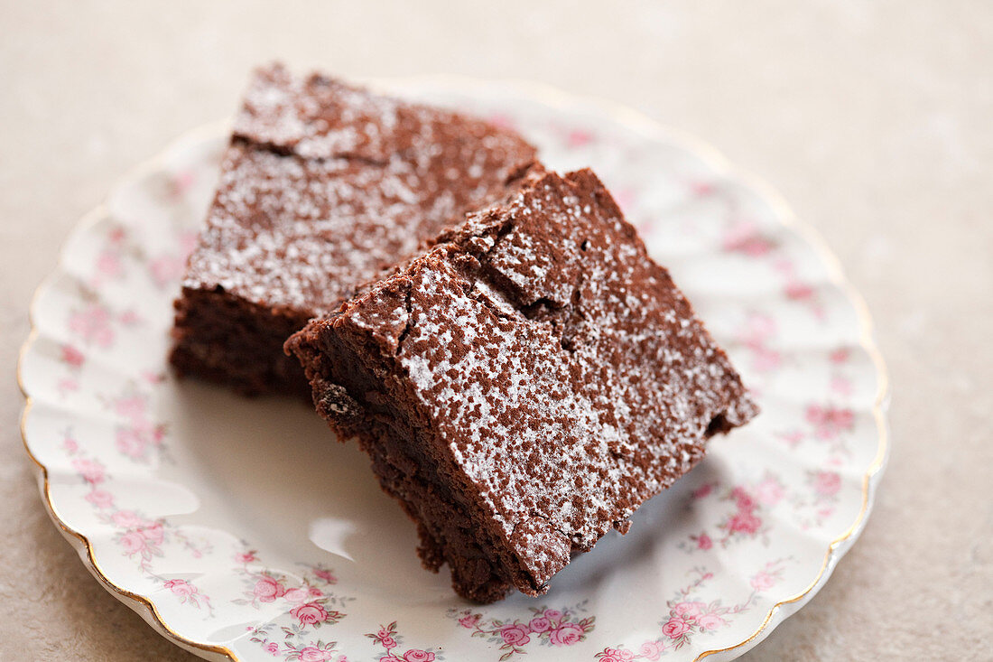 Chocolate brownie dusted with icing sugar