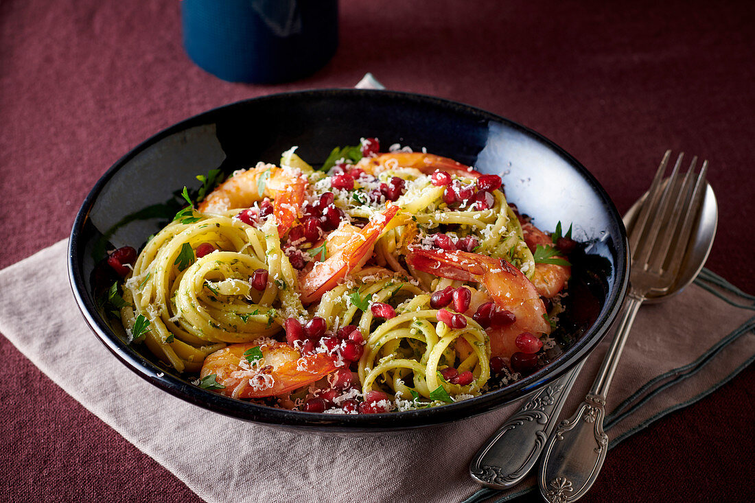 Linguine with prawns and pomegranate seeds