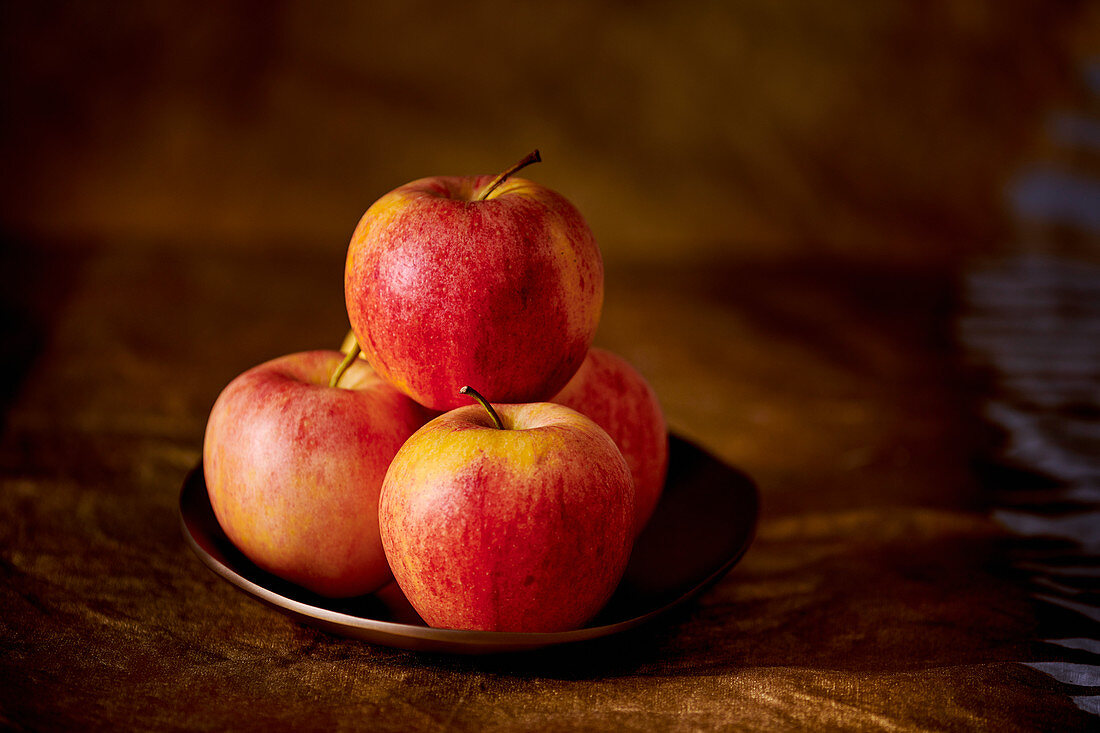 Red apples on a plate