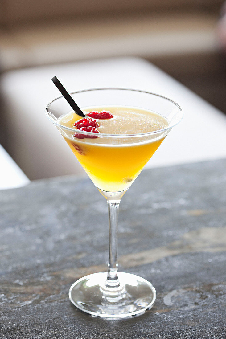 Cocktail with raspberries