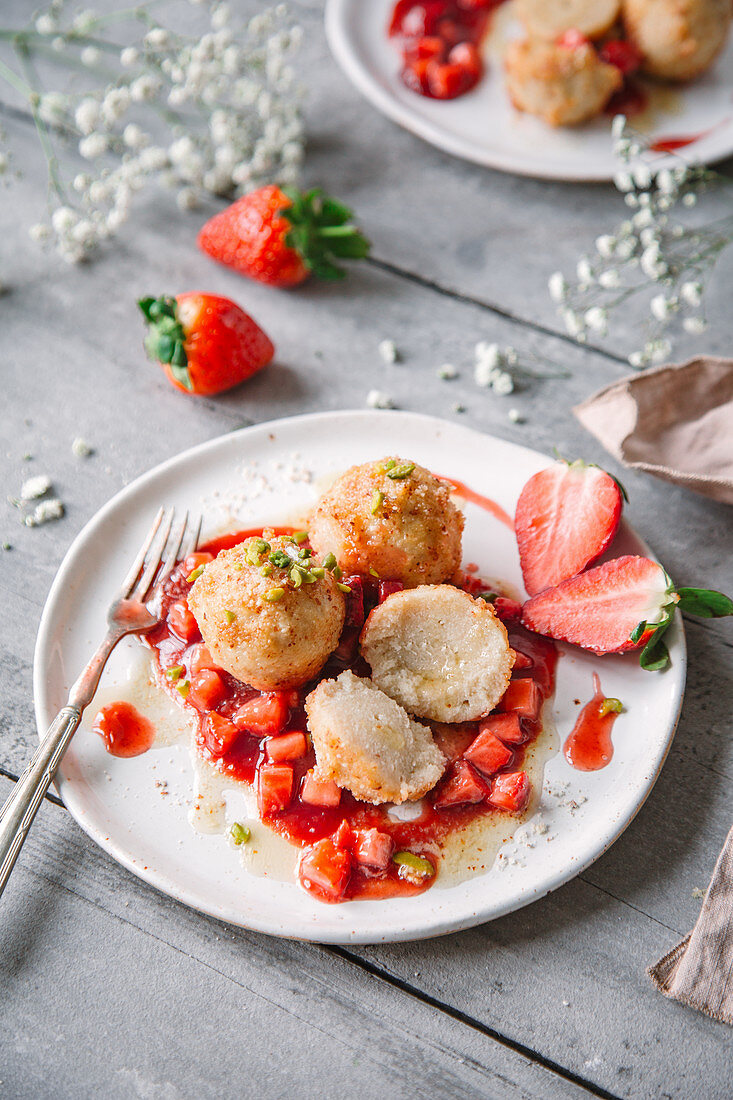 Potato dumplings with strawberry compote