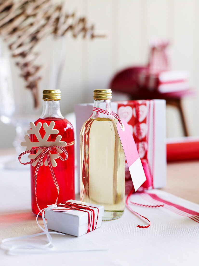 Homemade liqueurs in bottles decorated for Christmas