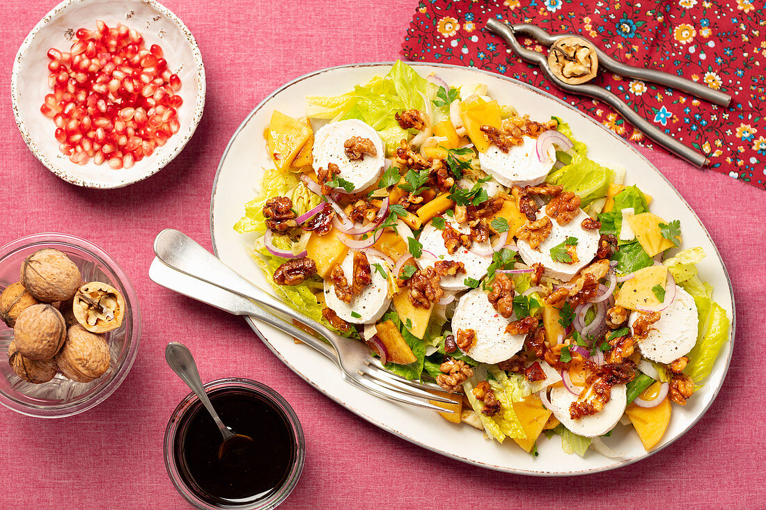 Salad with goats cheese, persimone and caramelized walnuts
