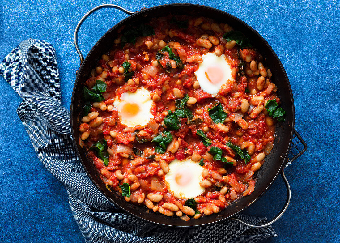 Shakshuka with silverbeet in a pan
