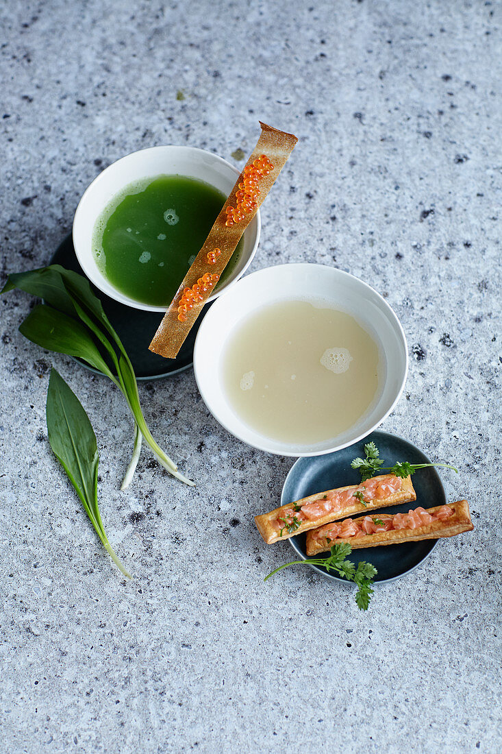 Wild garlic essence with trout caviar and asparagus essence with salmon