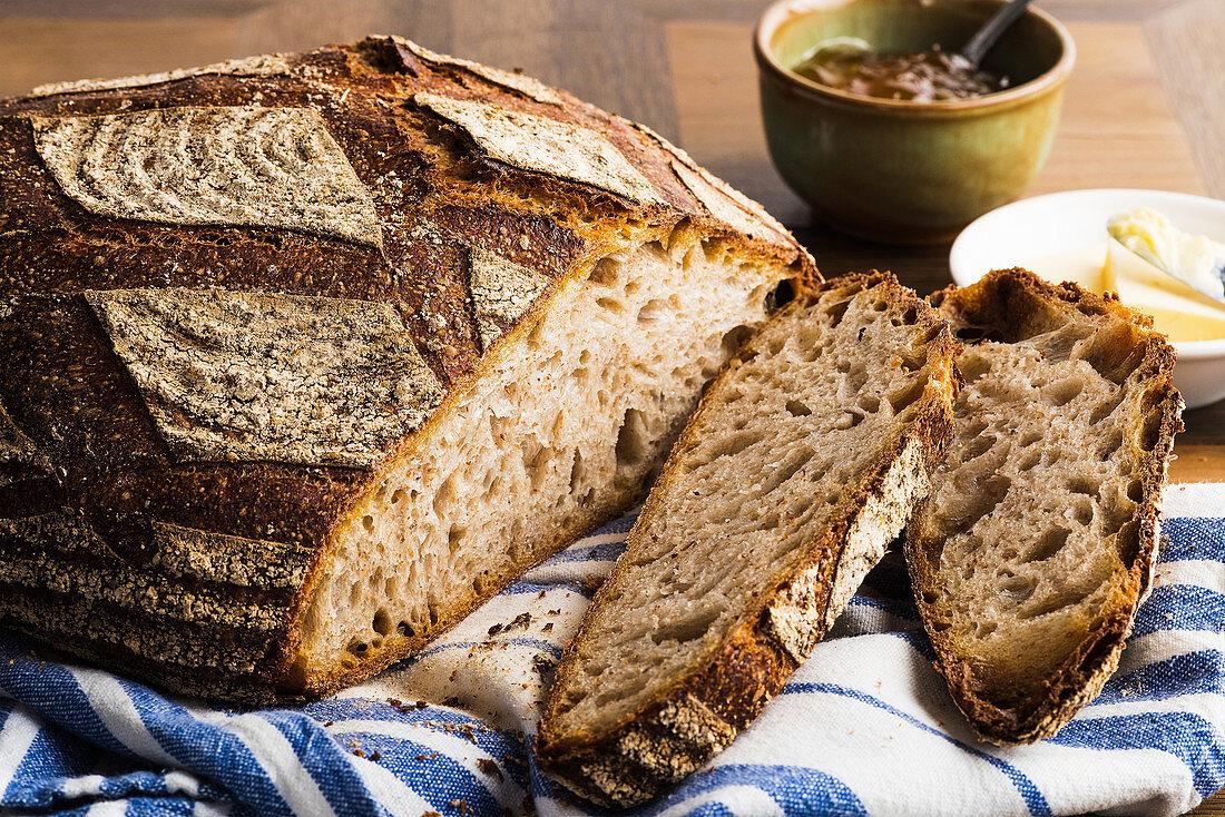 Rustic coarse rye bread, slices removed