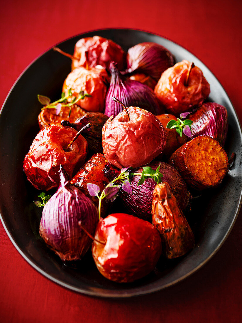 Roast apples onions and sweet potatoes with oregano