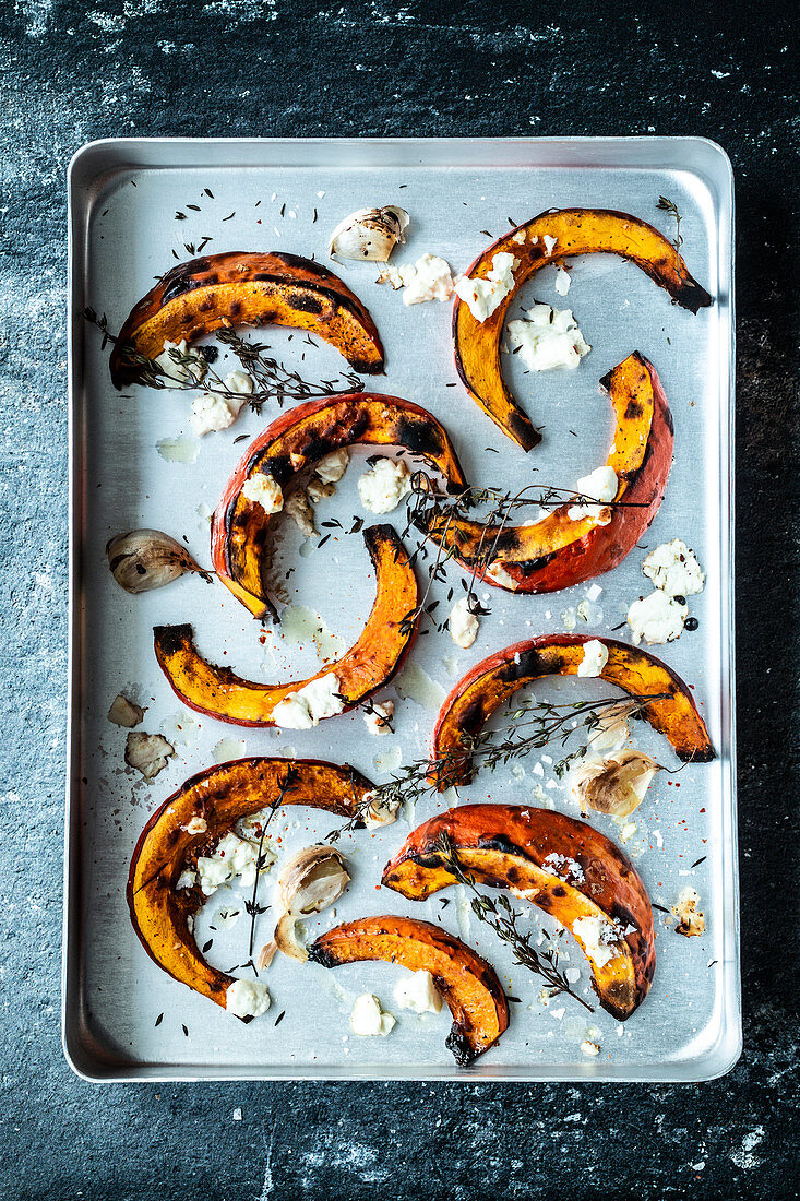 Pumpkin slices with garlic, thyme and feta cheese