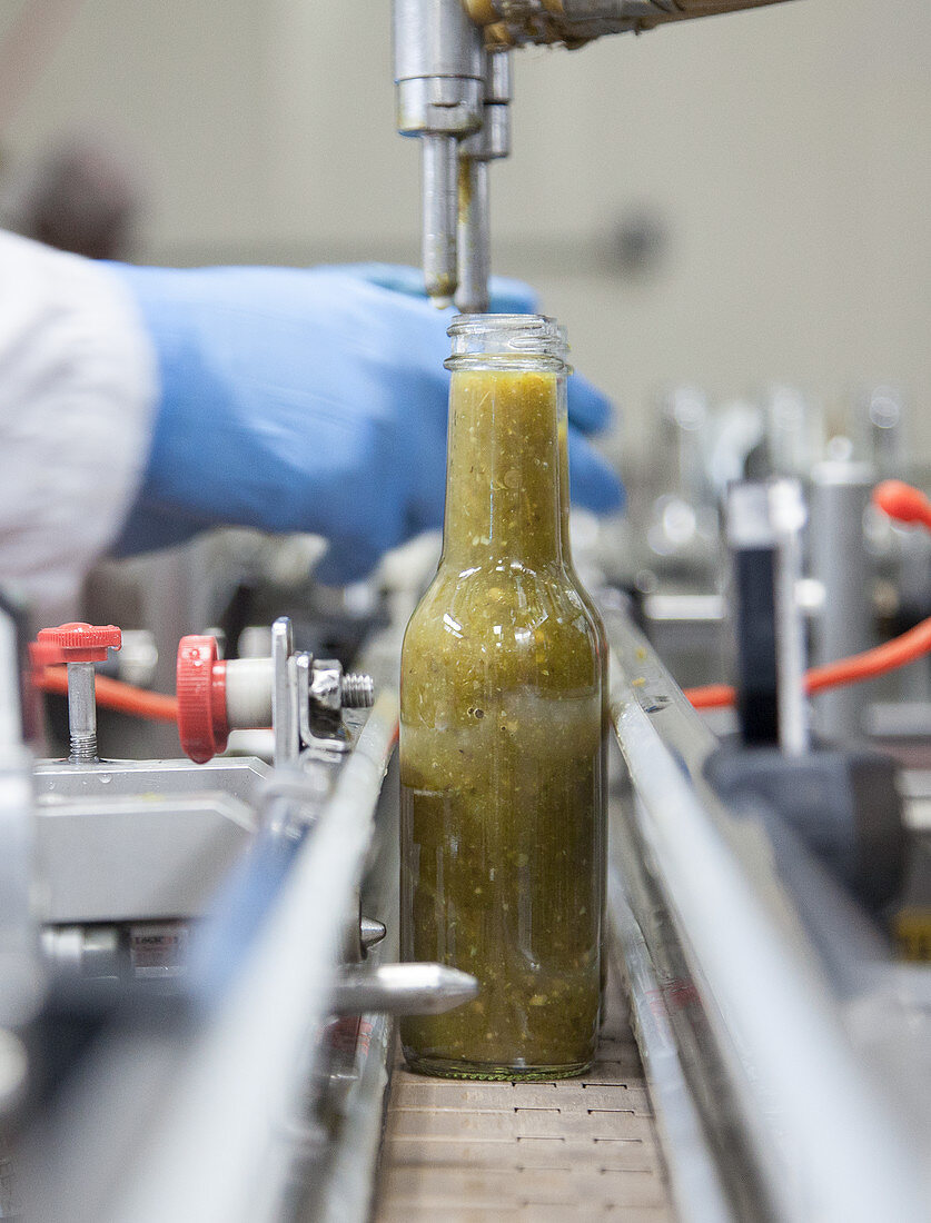 Hot sauce being bottled