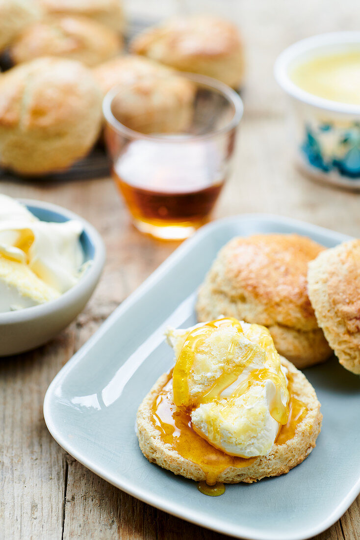 Scones with clotted cream and golden syrup