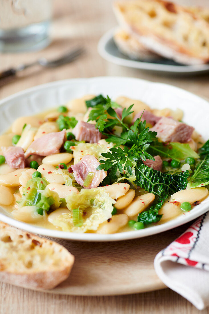White bean soup with savoy cabbage and ham