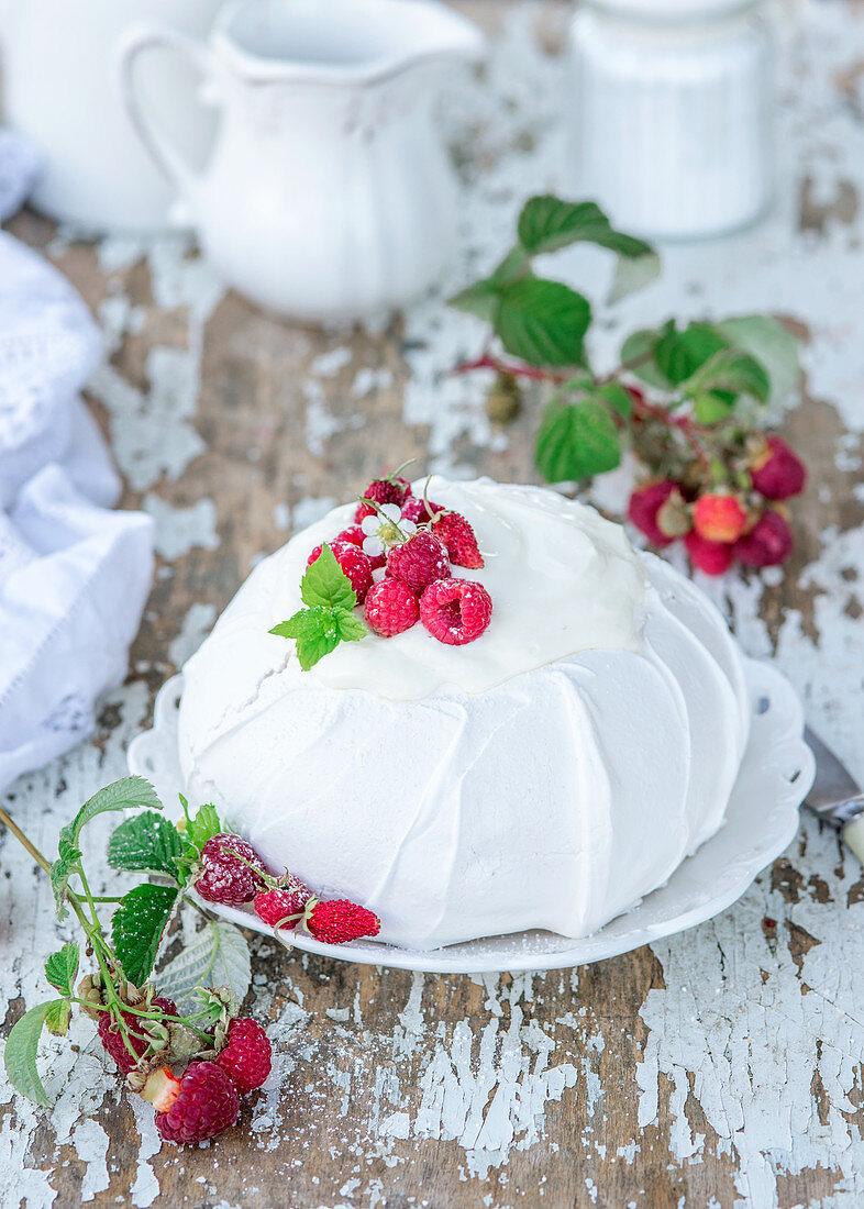Pavlova with raspberries and sour cream