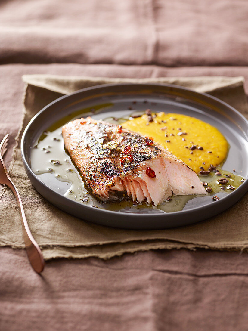 Salmon with a coffee, chilli and caraway crust on pumpkin purée
