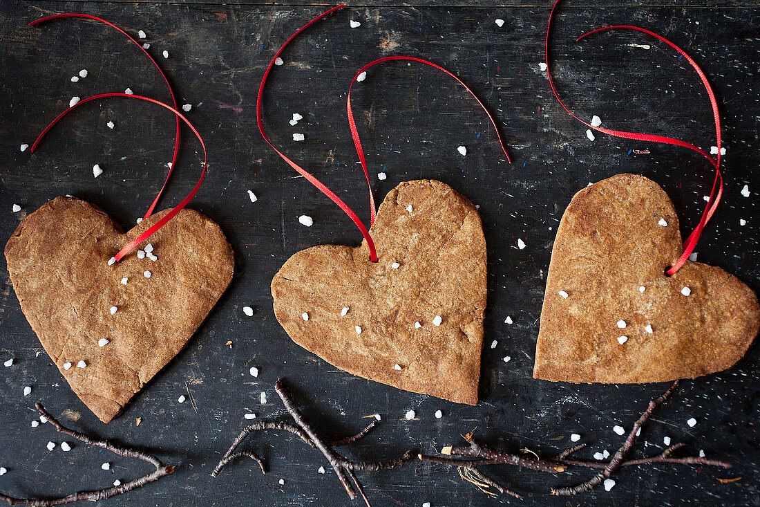 Heart shaped Christmas ginger biscuits with decorative ribbon